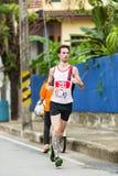 Lopende atleet in mini-marathonras Stock Afbeeldingen