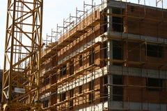 Lopende de bouw op bouwwerf Stock Foto