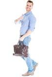 Lopende mens met laptop zak Royalty-vrije Stock Foto's