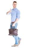 Lopende mens met laptop zak Stock Fotografie