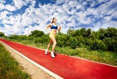 Lopende sportvrouw royalty-vrije stock fotografie
