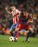 Lopez of Atletico fight with Alves of Barcelona. Lopez(L) of Atletico fight with Alves(R) of Barcelona during the match between FC Barcelona and Atletico Madrid Royalty Free Stock Photo
