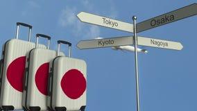 Loppbagage som presenterar flaggan av den begreppsmässiga animeringen Japan, för flygplan och för stadsteckenstolpe för japansk t lager videofilmer