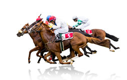 Lopphästar med jockey på den hem- raksträckan arkivfoton