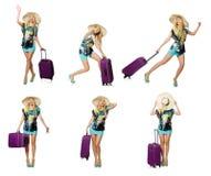 Loppsemesterbegreppet med bagage på vit Arkivfoto