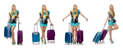 Loppsemesterbegreppet med bagage på vit Arkivbild