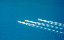 Loppsnabba motorbåtar Royaltyfria Bilder