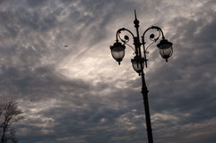 Lopsided streetlight. On the Patriarshiy bridge Royalty Free Stock Image