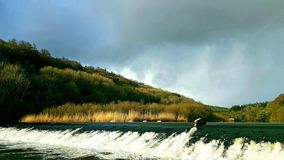 Lopwell Dam, River Tavy ,Dartmoor ,Devon. The SWLakesTrust . Lopwell Dam and salmon jump fast water running towards the river tamar from here the fresh water stock photo