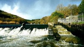 Lopwell Dam, salmonJump River Tavy ,Dartmoor ,Devon. The SWLakesTrust . Lopwell Dam and salmon jump fast water running towards the river tamar from here the royalty free stock photo