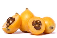 Loquat fruit. Close up view of some loquat fruit isolated on a white background Stock Photo