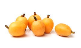 Loquat fruit. Close up view of some loquat fruit isolated on a white background Stock Image