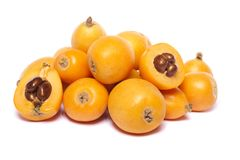 Loquat fruit. Close up view of some loquat fruit  on a white background Royalty Free Stock Photo