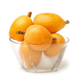 Loquat fruit. Close up view of some loquat fruit on a white background stock photography