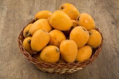 Loquat Medlar fruit. On the wood stock images