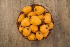 Loquat Medlar fruit. On the wood Royalty Free Stock Images