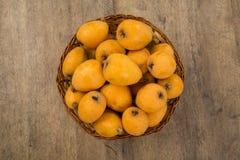 Loquat Medlar fruit. On the wood royalty free stock images