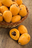 Loquat Medlar fruit. On the wood Stock Photography