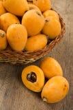 Loquat Medlar fruit. On the wood stock photography