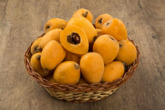 Loquat Medlar fruit. On the wood royalty free stock photo