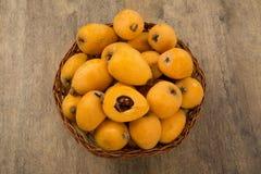 Loquat Medlar fruit. On the wood stock photos