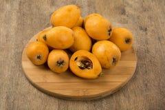 Loquat Medlar fruit. On the wood stock image