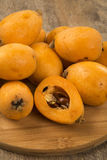 Loquat Medlar fruit. On the wood stock photo