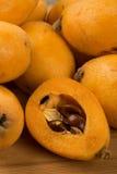 Loquat Medlar fruit. On the wood royalty free stock photos