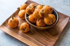 Loquat Plum Fruits / Eirobotrya Japonica Ready to Eat. Organic Food Stock Photo