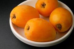 Loquats in bowl closeup Stock Photo