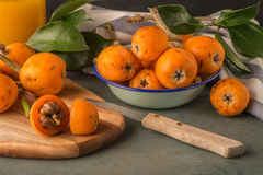 Loquats on kitchen counter Stock Photography