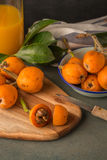 Loquats on kitchen counter Royalty Free Stock Images