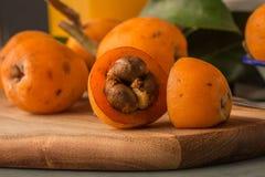 Loquats on kitchen counter Stock Photo