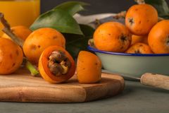 Loquats on kitchen counter Stock Images