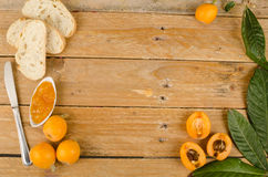 Loquats and marmalade background Stock Photos