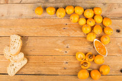 Loquats and marmalade background Royalty Free Stock Image