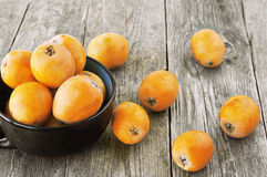 Free Loquats On Wooden Stock Images - 71837244