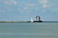 Lorain lighthouse. Image of Lorain Lighthouse and sailboat Royalty Free Stock Photography