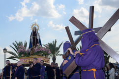 Penitents in a Via Crucis with crosses in Lorca Stock Photo