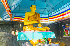 Lord Buddha con un vaso Fotografie Stock