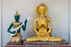 Lord Buddha doing self mortification and the god playing music to relief his stress Royalty Free Stock Images