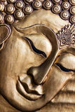 Lord Buddha's face wood carving. Royalty Free Stock Photo