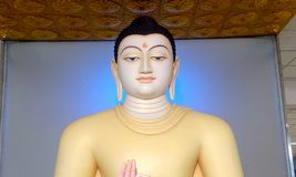 Lord buddha statue with sandal color in an airport srilanka. Lord buddha statur statue sandal color airport srilanka bhuddist srilankan chinese spiritual god royalty free stock photo