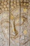 Lord Buddha u. x27; hölzernes Schnitzen s-Gesichtes Stockfotografie