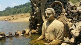 Lord Buddhas Statue In Srilanka Resovoire stock photo
