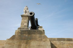 Lord Collingwood statue Tynemouth. Cannons and statue of Lord Collingwood looking out to sea at Tynemouth Royalty Free Stock Photography