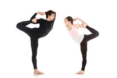 Lord of the Dance yoga pose in pair Stock Images