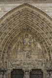 The Lord on facade of Notre Dame of Paris, France royalty free stock photography