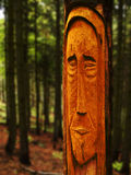 Lord of forest. Sculpture prepared from old tree directly in the forest Royalty Free Stock Image