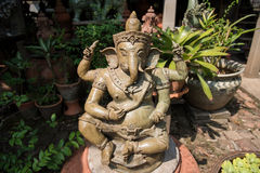 Lord Ganesh - Hindu God of Prosperity in the garden. Royalty Free Stock Image